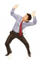 15192654-a-man-in-shirt-and-tie-acting-afraid-of-being-crushed-on-white-background
