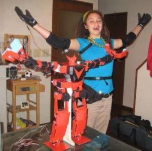 girl pilots fighting robot